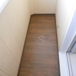 фото обшивки балкона неправильной формы пластиковыми панелями под ключ