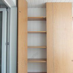 Встроенные шкафы на лоджии после остекления и обшивки ПВХ вагонкой