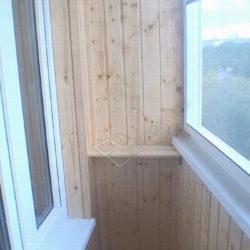 Капитальный ремонт балкона с раздвижным остеклением и обшивкой деревянной вагонкой