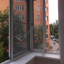 Раздвижное холодное остекление балкона алюминиевыми окнами