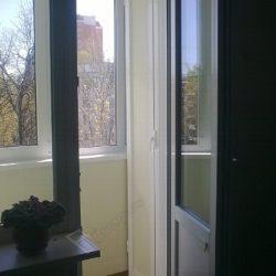 Балкон обустроенный шкафом на заказ после остекления и отделки под ключ